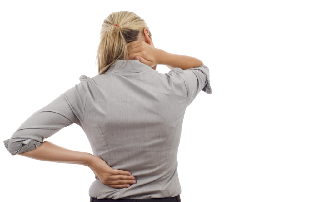 Woman experiencing middle and upper back pain
